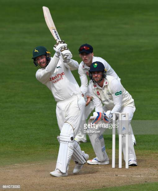 Nottinghamshire batsman Riki Wessels hits out watched by wicketkeeper Chris Cooke during a pre season friendly between Glamorgan and Nottinghamshire...