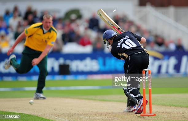 Nottinghamshire bowler Luke Fletcher bowls Warwickshire batsman William Porterfield during the Friends Life T20 match between Nottinghamshire and...