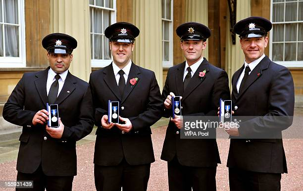 Nottinghamshire Firemen Sanjeev Mohia Daniel Wareham Matthew Willis and Andrew Alexander with their Queen's Gallantry Medals presented to them by...