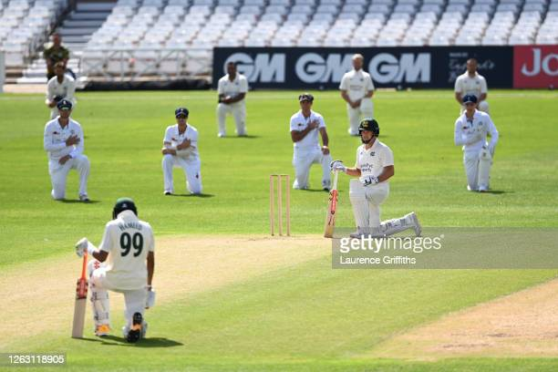 "Nottinghamshire opening batsmen Chris Nash and Haseeb Hameed take the knee in support of ""Black Lives Matter"" along with the Derbyshire team at Trent..."
