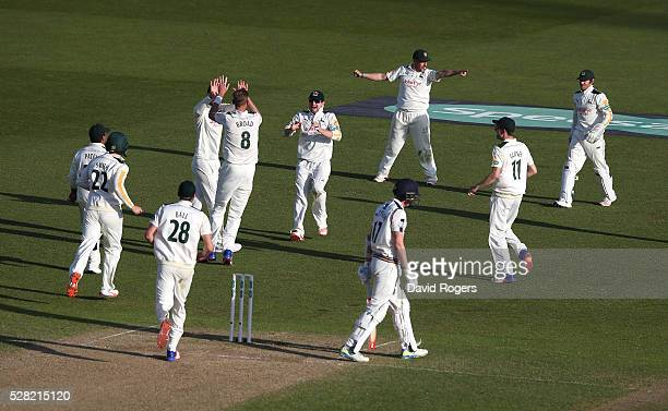 Nottinghamshire players celebrate after Steven Patterson is trapped LBW off the bowling of Stuart Broad during the Specsavers County Championship...