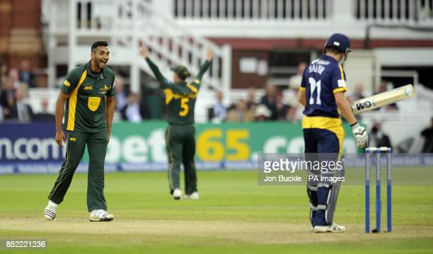 Nottinghamshire's Ajmal Shahzad celebrates claiming the wicket of Glamorgan's Andrew Salter during the Yorkshire Bank Pro40 Final at Lord's Cricket...