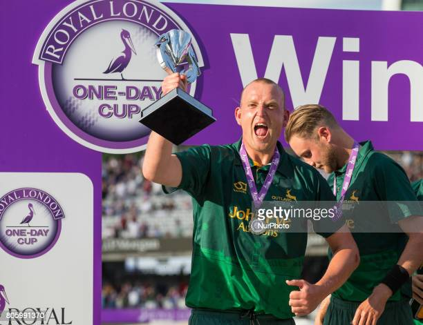 Nottinghamshire's Luke Fletcher with the winner Trophy during the Royal London OneDay Final match between Nottinghamshire and Surrey at Lord's...
