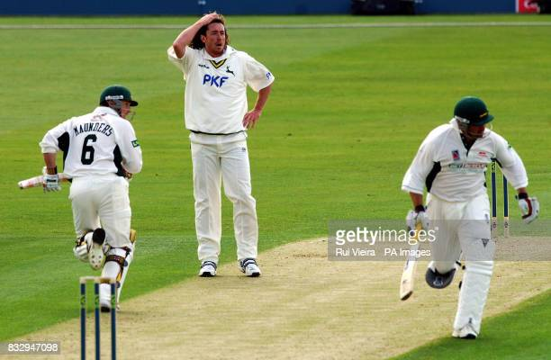 Nottinghamshire's Ryan Sidebottom watches Leicestershire's John Maunders and Darren Robinson on the way to a century partnership during the Liverpool...