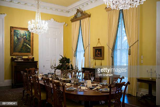 Nottoway plantation 19th Century antebellum mansion dining room with table settings and chandelier in Louisiana USA