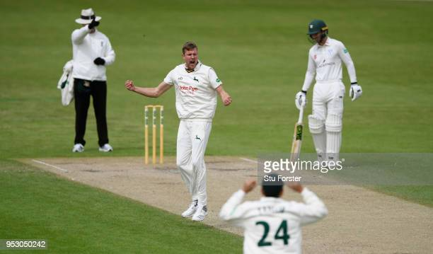 Notts bowler Jake Ball celebrates as umpire Richard Illingworth sends Worcestershire batsman Travis Head on his way for 29 runs during day four of...