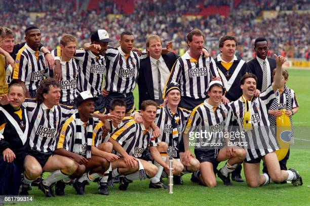 Notts County celebrate gaining promotion to Division One Dave Regis Paul Harding Charlie Palmer Alan Paris Kevin Blackwell assistant manager Wayne...