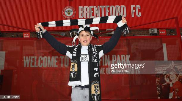 Notts County fan poses outside the ground prior to The Emirates FA Cup Third Round match between Brentford and Notts Country at Griffin Park on...