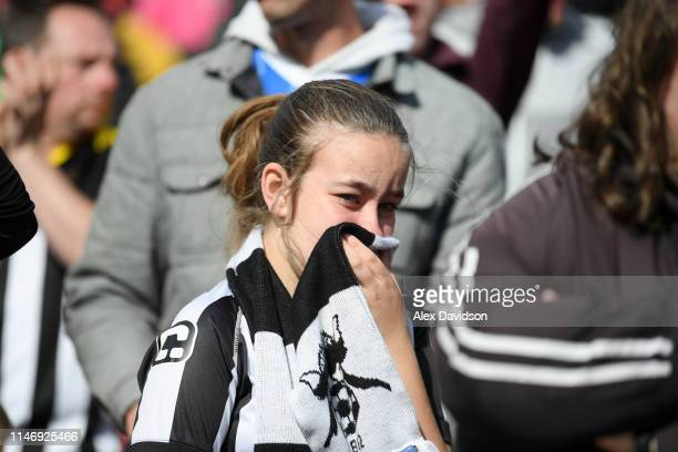 Notts County fans look dejected after the Sky Bet League Two match between Swindon Town and Notts County at County Ground on May 04, 2019 in Swindon,...