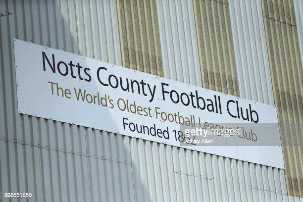 Notts County Football Club the World's Oldest Football League Club sign hangs on a stand during a PreSeason match between Notts County and Derby...