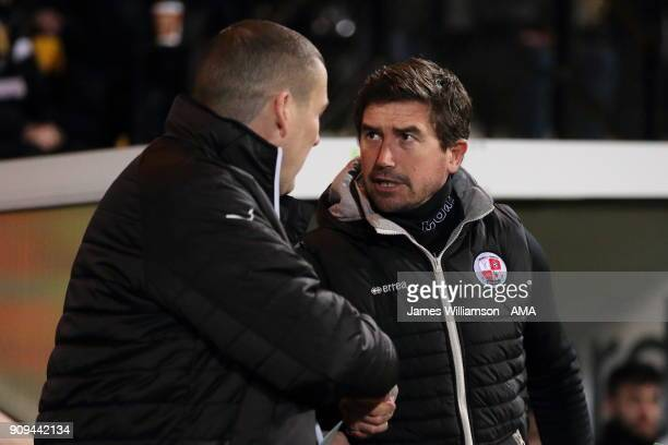 Notts County goalkeeping coach Mark Crossley and Crawley Town manager Harry Kewell during the Sky Bet League Two match between Notts County and...