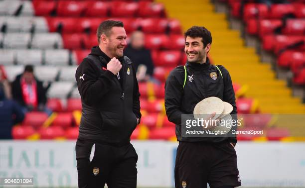 Notts County manager Kevin Nolan with Mike Edwards prior to the Sky Bet League Two match between Lincoln City and Notts County at Sincil Bank Stadium...