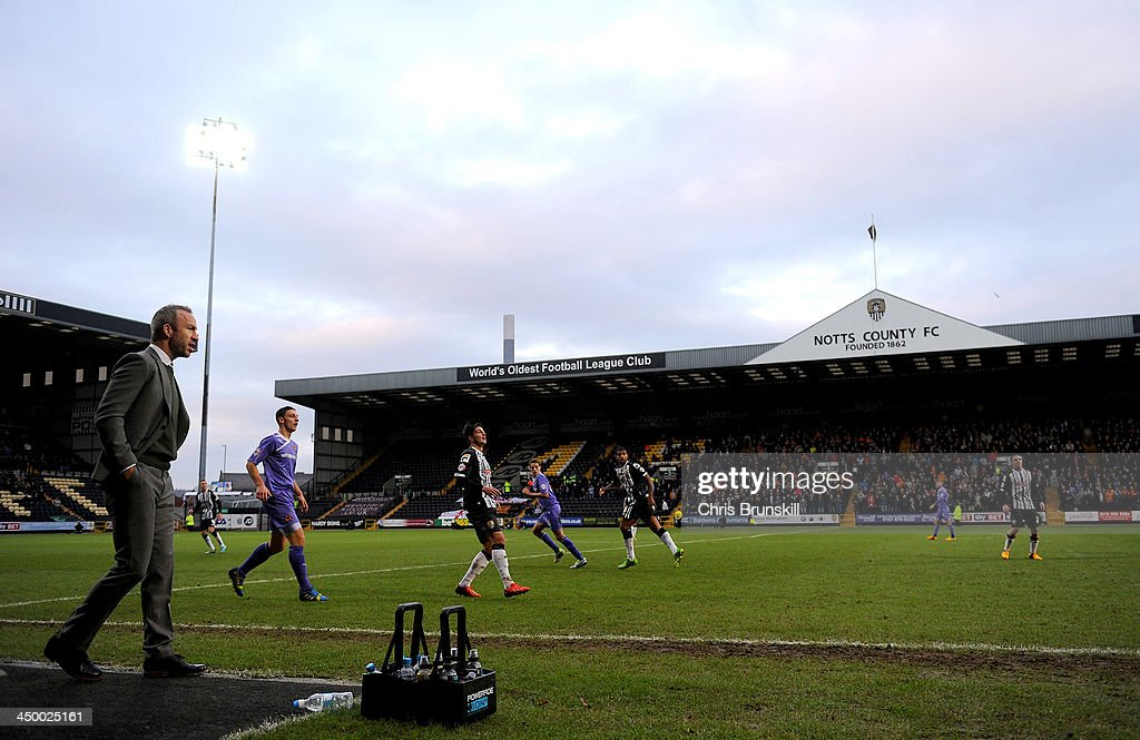 Notts County manager Shaun Derry (L) looks on from the touchline during the Sky Bet League One match between Notts County and Wolverhampton Wanderers at Meadow Lane on November 16, 2013 in Nottingham, England.