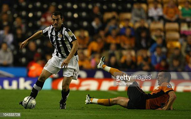 Notts County player Mike Edwards runs past the challenge of Nenad Milijas of Wolves during the Carling Cup 3rd Round match between Wolverhampton...