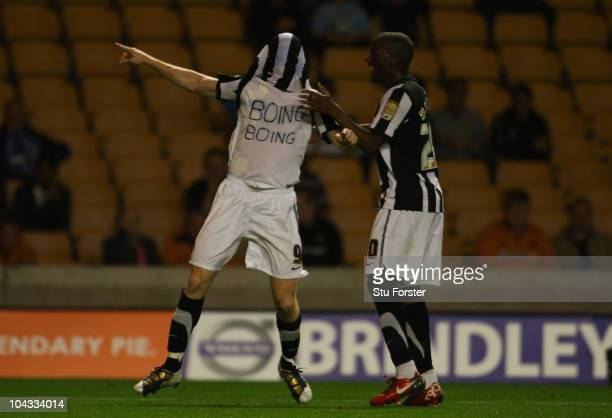 Notts County striker Lee Hughes celebrates his goal during the Carling Cup 3rd Round match between Wolverhampton Wanderers and Notts County at...