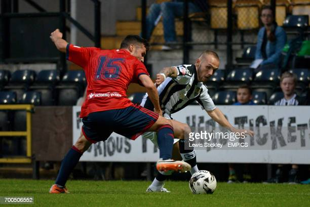 Notts County's Adam Dawson and CA Osasuna's Oier Sanjuro battle for the ball