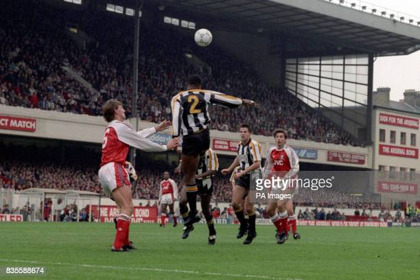 Notts County's Charlie Palmer heads the ball clear from Arsenal's Tony Adams Also pictured is Dean Yates and Alan Smith