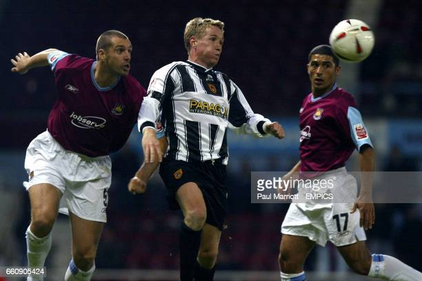 Notts County's Glynn Hurst battles for the ball with West Ham United's Andy Melville and Hayden Mullins
