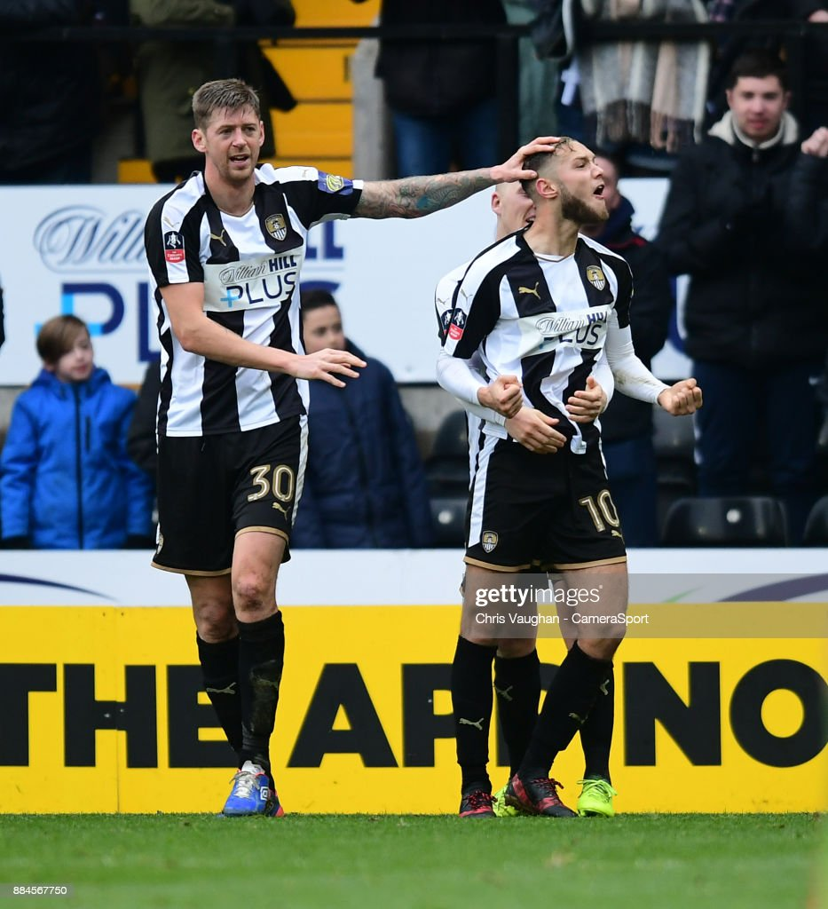 Notts County's Jorge Grant, right, celebrates scoring his sides third goal with team-mates Jonathan Stead, left, and Terry Hawkridge during the Emirates FA Cup Second Round match between Notts County and Oxford City at Meadow Lane on December 2, 2017 in Nottingham, England.