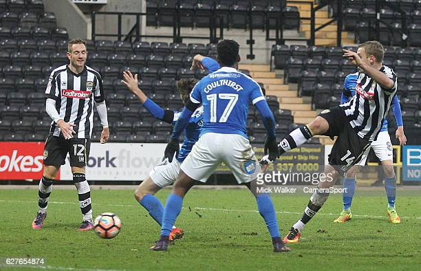 NOTTINGHAM ENGLAND DECEMBER Notts County's Louis Laing scores his sides second goal during the Emirates FA Cup Second Round match between Notts...