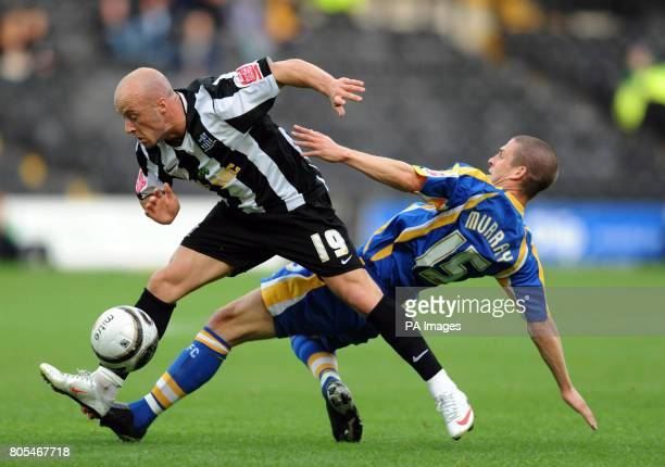 Notts County's Luke Rodgers and Shrewsbury Town's Paul Murray battle during the CocaCola League Two match at Meadow Lane Nottingham