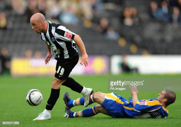Notts County's Luke Rodgers and Shrewsbury Town's Paul Murray battle for the ball during the CocaCola League Two match at Meadow Lane Nottingham