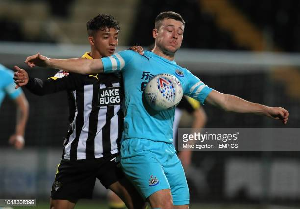 Notts County's Tyler Walker and Newcastle United U21's Callum Roberts battle for the ball Notts County v Newcastle United U21 Checkatrade Trophy...