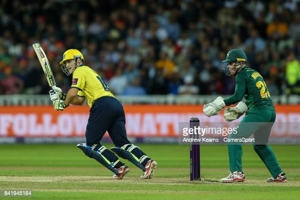 Notts Outlaws' Tom Moores looks on as Birmingham Bears' Sam Hain drives during the NatWest T20 Blast Final match between Birmingham Bears and Notts...