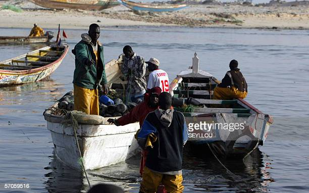 Fishermen prepare to leave 11 March 2006 the local fishing port of Charca Nouadibou where wouldbe clandestine immigrants to Europe board vessels that...