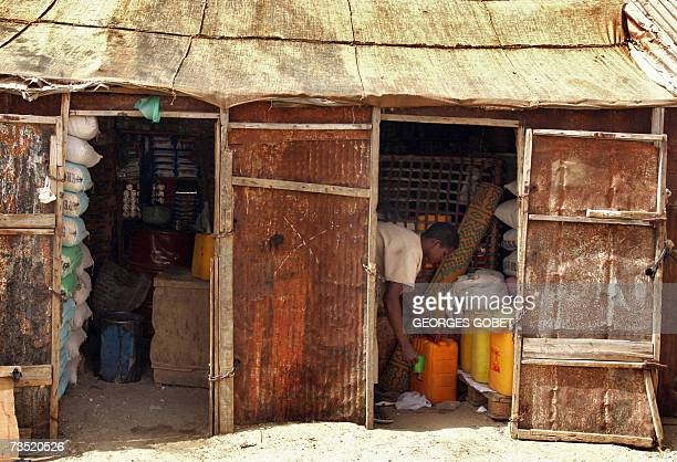 TO GO WITH AFP FRENCH STORY BY CHRISTOPHE PARAYRE A Mauritanian man arranges his products inside his shop 07 March 2007 in a shanty town in...