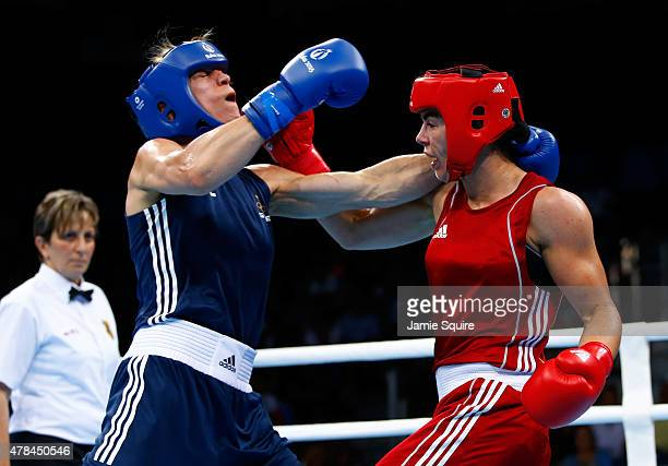 Nouchka Fontijn of the Netherlands and Anna Laurell Nash of Sweden compete in the Women's Middleweight 6975kg final on day thirteen of the Baku 2015...