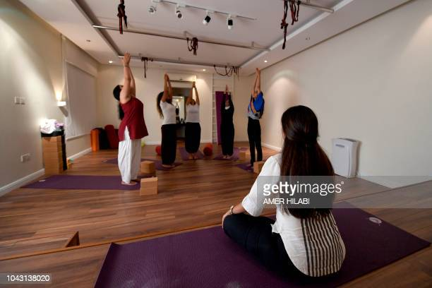 Nouf Marwaai the head of the Arab Yoga Foundation instructs her yoga students with at her studio in the western Saudi Arabian city of Jeddah on...
