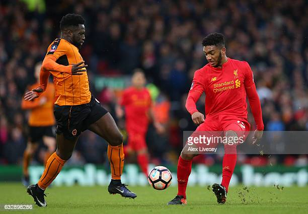 Nouha Dicko of Wolverhampton Wanderers and and Joe Gomez of Liverpool compete for the ball during the Emirates FA Cup Fourth Round match between...