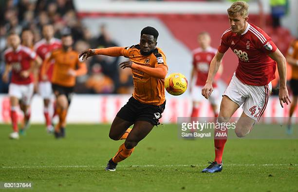 Nouha Dicko of Wolverhampton Wanderers and Joe Worrall of Nottingham Forest during the Sky Bet Championship match between Nottingham Forest and...