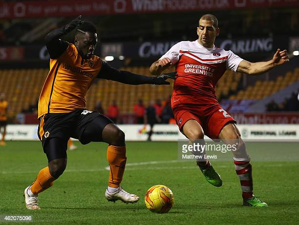 Nouha Dicko of Wolverhampton Wanderers and Tal Ben Haim of Charlton Athletic challenge for the ball during the Sky Bet Championship match between...