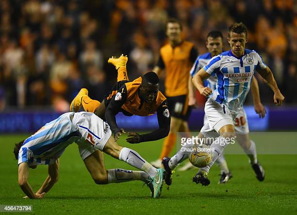 Nouha Dicko of Wolverhampton Wanderers is challenged by Jack Robinson and Jonathan Hogg of Huddersfield Town during the Sky Bet Championship match...