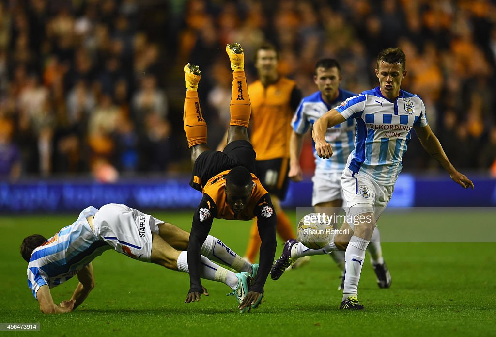 Nouha Dicko of Wolverhampton Wanderers is challenged by Jack Robinson and Jonathan Hogg of Huddersfield Town during the Sky Bet Championship match between Wolverhampton Wanderers and Huddersfield Town at Molineux on October 1, 2014 in Wolverhampton, England.