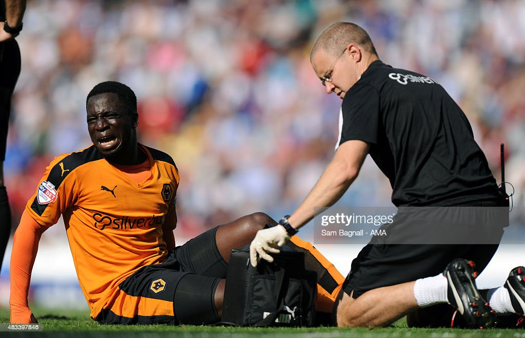 Nouha Dicko of Wolverhampton Wanderers receives treatment for an injury during the Sky Bet Championship match between Blackburn Rovers and Wolverhampton Wandereres at Ewood park on August 8, 2015 in Blackburn, England.