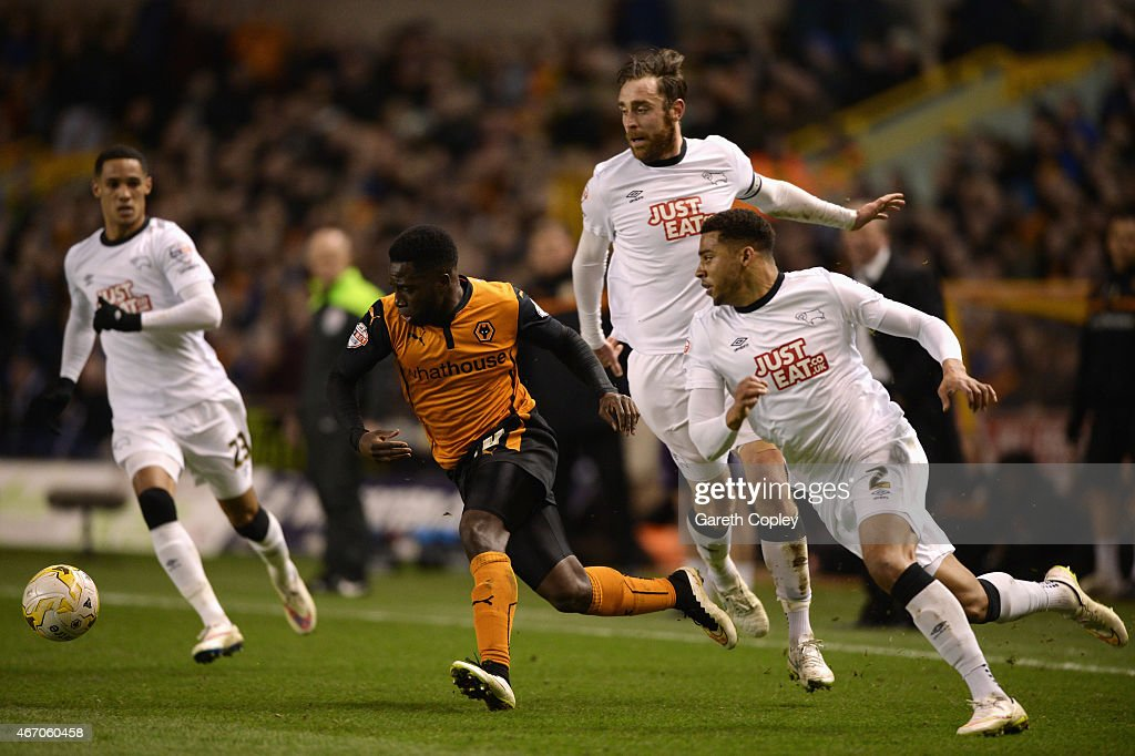 Nouha Dicko of Wolves goes past Cyrus Christie (R), Tom Ince (L) and Richard Keogh of Derby during the Sky Bet Championship match between Wolverhampton Wanderers and Derby County at Molineux on March 20, 2015 in Wolverhampton, England.