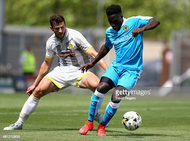 Nouha Dicko of Wolves moves away from John Mousinho during the pre season friendly match between Burton Albion and Wolverhampton Wanderers at the...