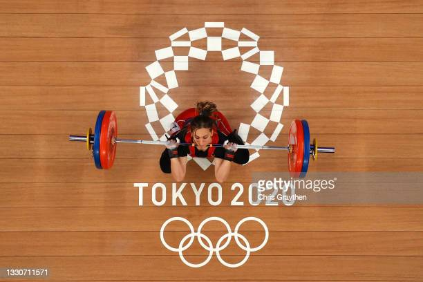 Nouha Landoulsi of Team Tunisia competes during the Weightlifting - Women's 55kg Group A on day three of the Tokyo 2020 Olympic Games at Tokyo...