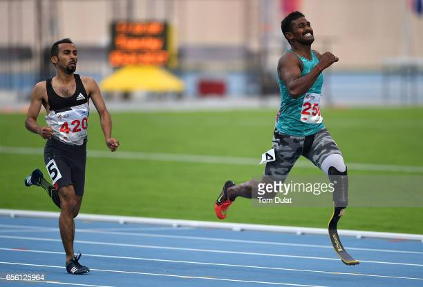 Nour Alsana of Saudi Arabia and Anandan Gunasekaran of India compete in 400m Men's race during the 9th Fazza International IPC Athletics Grand Prix...