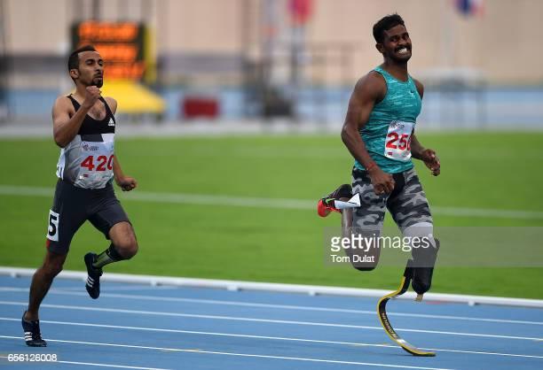 Nour Alsana of Saudi Arabia and Anandan Gunasekaran of India compete in 400m Men's race during the 9th Fazza International IPC Athletics Grand Prix...