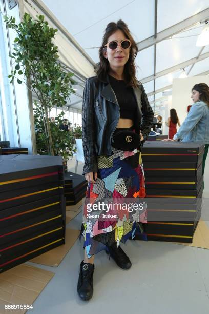 Nour Altamimi of Saudi Arabia wears a patchwork skirt by Christopher Kane at the Untitled Art Fair during Art Basel Miami Beach on December 05 2017...