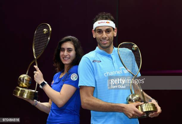 Nour El Sherbini of Egypt and Mohamed Elshorbagy of Egypt pose with the trophies after winning their final matches of the PSA Dubai World Series...