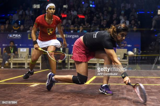 Nour El Sherwin of Egypt plays against Nouran Gohar of Egypt during the women's finals of JP Morgan China Squash Open 2017 in Shanghai on September 3...