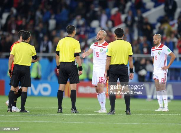 Noureddine Amrabat of Morocco and referee Ravshan Ermatov during the 2018 FIFA World Cup Russia group B match between Spain and Morocco at...