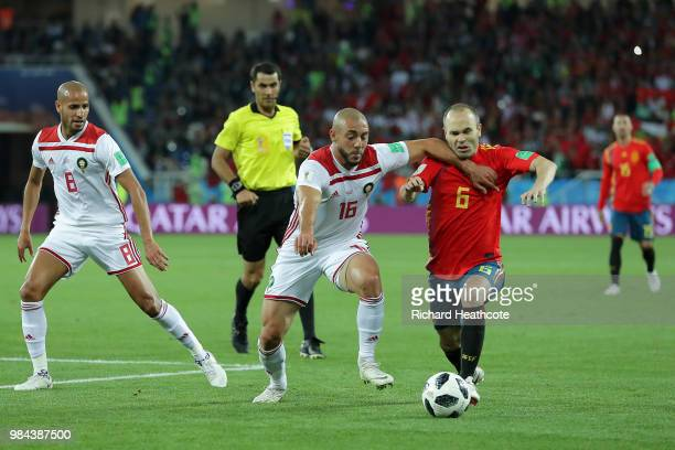 Noureddine Amrabat of Morocco battles with Andres Iniesta of Spain during the 2018 FIFA World Cup Russia group B match between Spain and Morocco at...