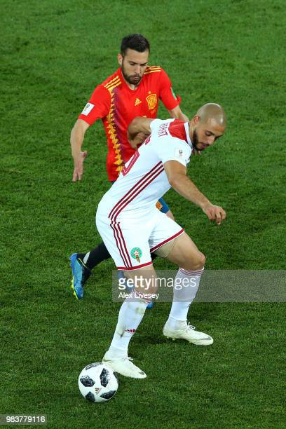 Noureddine Amrabat of Morocco is challenged by Jordi Alba of Spain during the 2018 FIFA World Cup Russia group B match between Spain and Morocco at...