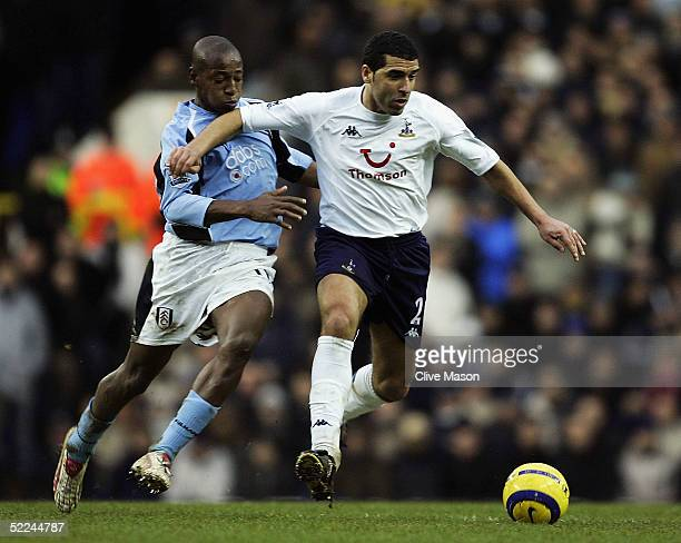 Noureddine Naybet of Tottenham Hotspur is challenged by Luis Boa Morte of Fulham during the Barclays Premiership match between Tottenham Hotspur and...